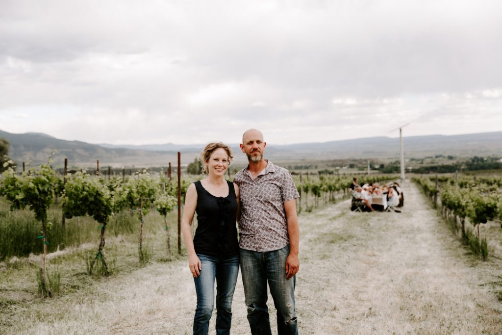 Owners and winemakers of The Storm Cellar, Jayme Henderson and Steve Steese, standing in the Riesling vines at their first wine dinner in the vineyard.